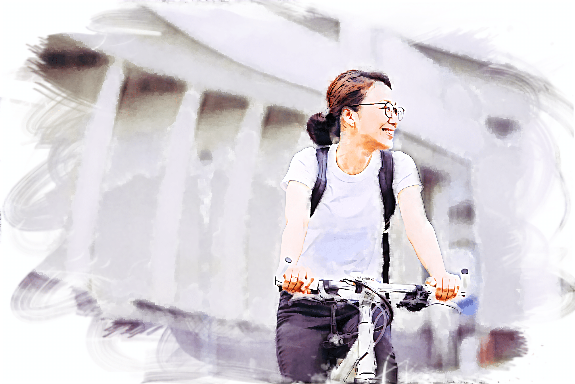 電動アシスト自転車でポタリングしている女性